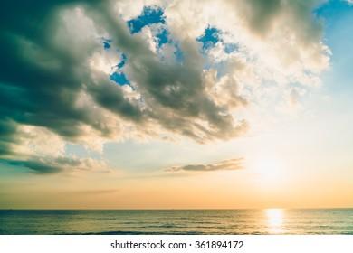 Beautiful Sunrise and sea on the beach - Vintage filter
