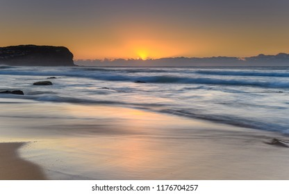 Beautiful Sunrise Seascape with Low Cloud Bank - Taken at MacMasters Beach on the Central Coast, NSW, Australia.