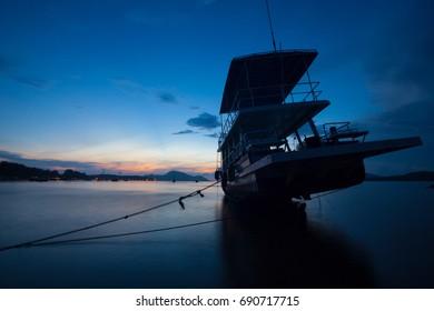 Beautiful sunrise seascape view with boat in phuket island