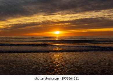 A beautiful sunrise from the shore of the beach, Spain