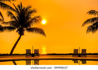 Beautiful Sunrise with silhouette coconut palm tree and chair pool around swimming pool in beautiful luxury hotel resort - Vintage Filter