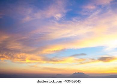 Beautiful sunrise sky and clouds over mountain.