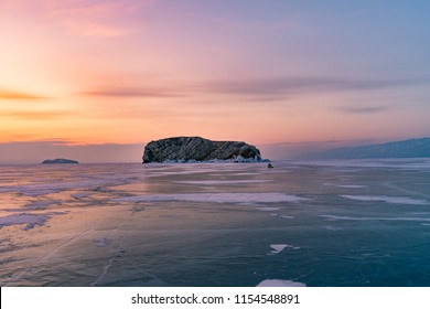 Beautiful sunrise sky over frozen water lake Baikal Siberia, winter season natural landscape background