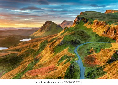 Beautiful sunrise sky over rock formations on the Quiraing, an ancient landslip on the eastern face of Meall na Suiramach on the Ilse of Skye in Scotland