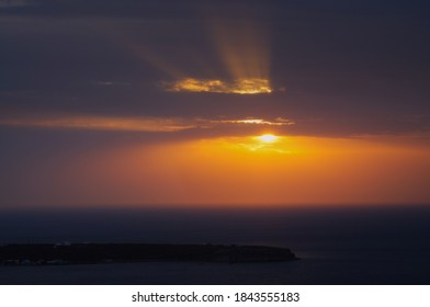 Beautiful sunrise at Thirasia island, view from Santorini Oia village