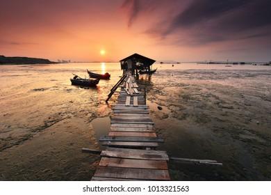 Beautiful sunrise view at fisherman jetty in Jelutong, Penang Malaysia. Nature composition
