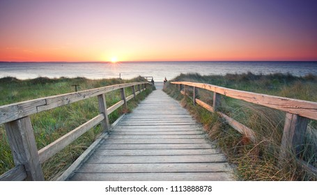 beautiful sunrise at the wooden beach access to the ocean