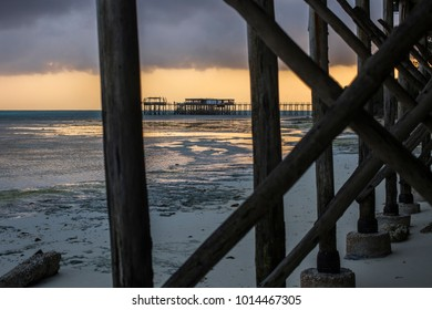 Beautiful sunrise at Zanzibar. Wooden sea dock stretching over the sea at sunrise, Nungwi, Zanzibar, Tanzania