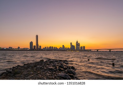 Beautiful Sunset 63 building at Seoul city and Downtown skyline in Seoul, South Korea.
