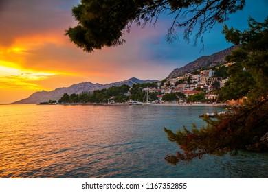 beautiful sunset above Adriatic sea and coastline in Brela, Makarska Riviera, Croatia