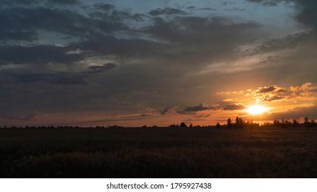 beautiful sunset above autumn filed