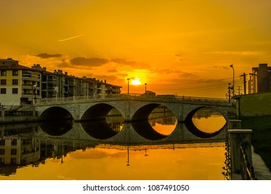 Beautiful sunset above the bridge that is making reflection in the water. View from the famous park Akarcay in Afyonkarahisar in Turkey