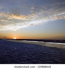 Beautiful sunset above underwater reef.  Red sea in Egypt. Blue sky and clouds above blue water