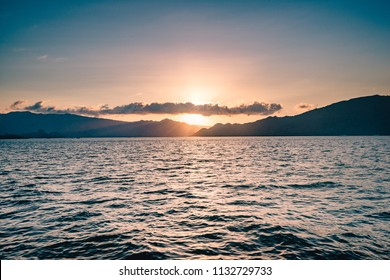 Beautiful sunset across the horizon of the blue ocean