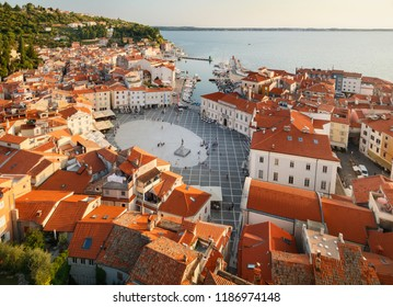 Beautiful sunset aerial view on Piran town with Tartini main square, ancient buildings with red roofs and Adriatic sea in southwestern Slovenia