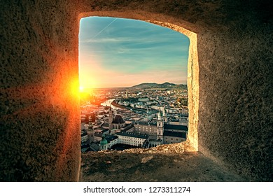 Beautiful sunset aerial view on Salzburg, Austria, Europe. City in Alps of Mozart birth. View of Salzburg skyline from Festung Hohensalzburg castle fortress window.