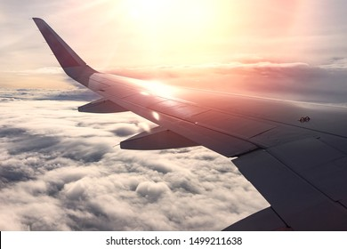 beautiful sunset aerial view wing of airplane from window seat