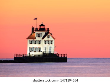 A beautiful sunset afterglow over the Lorain, Ohio Lighthouse at Lake Erie. I added no color to this image...this is how my camera captured it.