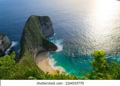 Beautiful sunset and amazing view of Kelingking beach or Manta bay on Nusa Penida island, Bali, Indonesia
