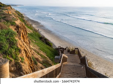 Beautiful sunset background of wooden steps leading down to the ocean during a calm, warm day in Cardiff by the Sea, California, north of San Diego on the Pacific Coast