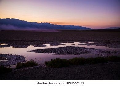 Beautiful sunset at Badwater Basin, the lowest point in North America, in Death Valley National Park (California).