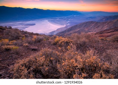 Beautiful sunset at Badwater basin seen from Dante's view, Death Valley, California, USA.