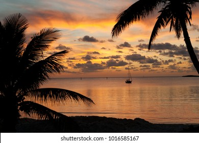 Beautiful sunset from the beach in Chub Cay, Bahamas with my sailboat Arcturus in the background.