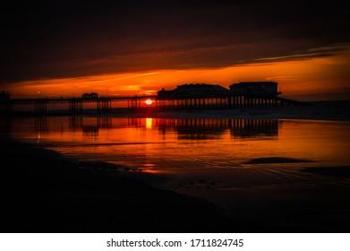 Beautiful sunset behind Cromer Pier on the North Norfolk coast.