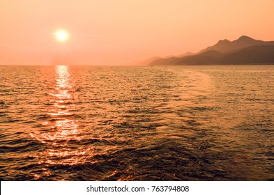 Beautiful sunset behind the Mljet island in Croatia, Europe. Mljet island from a sailboat.