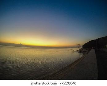 Beautiful sunset with blue sky and orange over the sea on the island of Gili Trawangan Indonesia