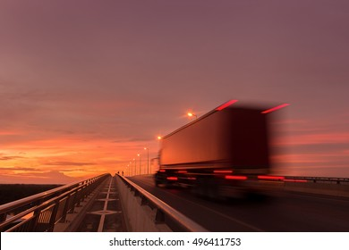 Beautiful sunset with Blurred truck on the road