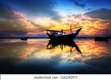 Beautiful Sunset Boats in seaside with red and dark sky. Dammam -Saudi Arabia