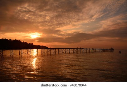 Beautiful sunset at the bridge by the sea, the shadow landscape concept. (Location: Kood Island, Trat Province, Thailand)