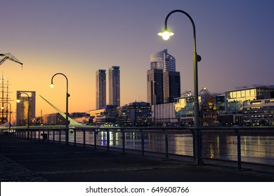 Beautiful sunset with buildings in background, Puerto Madero, Buenos Aires, Argentina.