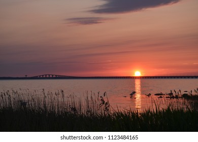 Beautiful sunset by the Olandbridge in Sweden, The bridge is connecting the island Oland with mainland Sweden