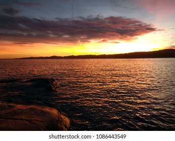 Beautiful sunset by the shore of Larvik, Norway.