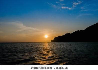 Beautiful sunset in a caribean beach. Taganga