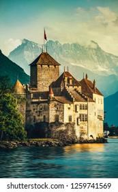 Beautiful sunset of Chillon Castle with Mont Blanc at Geneva lake, Switzerland