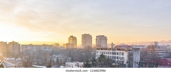 Beautiful sunset in Chisinau town. Warm light reflecting on buildings. Purple blue sky on background. Negative copy space, place for text. Moldova beauties