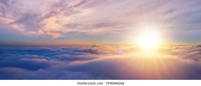 Beautiful sunset cloudy sky from aerial view. Airplane view above clouds - Shutterstock ID 1930446266