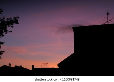 Beautiful sunset with colorful skies above the building silhouettes.