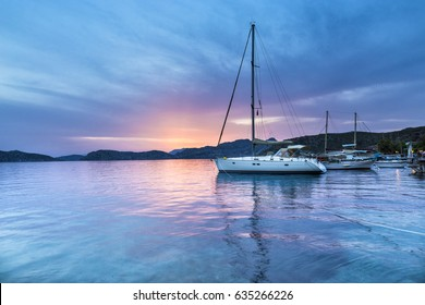 Beautiful sunset colors on the sea at Sogut. Sogut is a village in Marmaris District, Mugla Province, Turkey. It belongs to the municipality of Bozburun, in the Bozburun peninsula.