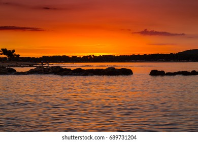 Beautiful sunset colors and silhouettes on the Adriatic Sea, in summer