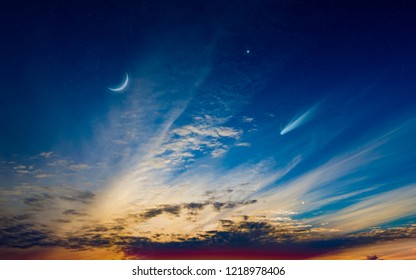 Beautiful sunset with crescent moon, glowing clouds and bright star. Elements of this image furnished by NASA