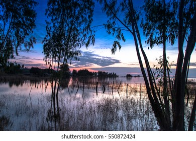 beautiful sunset at dam in thailand
