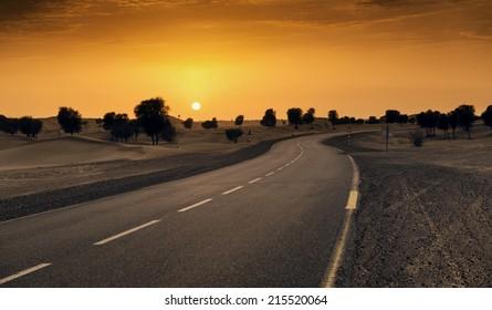 Beautiful sunset in desert road in Dubai, UAE