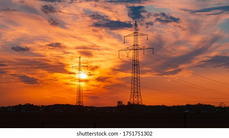 Beautiful sunset with dramatic clouds and powerlines near Tabertshausen, Bavaria, Germany