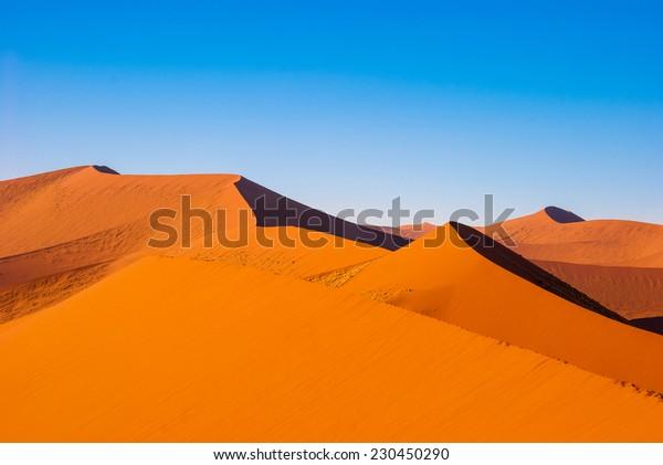 Beautiful sunset dunes and nature of Namib desert, Sossusvlei, Namibia, South Africa