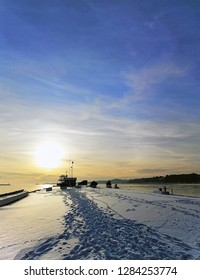 Beautiful sunset during the winter. The bridge in the centre of Larvik, Norway. Footprints in the snow.