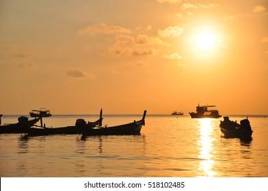 beautiful sunset and fishing boat around seaside , South Thailand